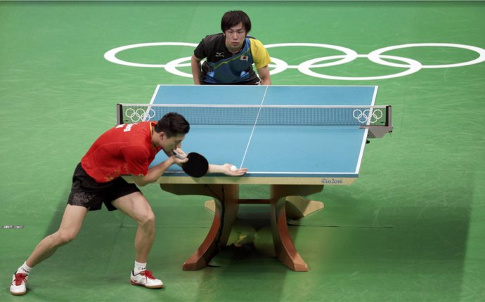 Chinese men s table tennis overcomes singles loss to win team